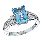 Blue aquamarine and white diamond gold ring.