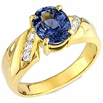 Blue spinel and white diamond gold ring.