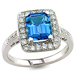 Blue topaz and white diamond gold ring.