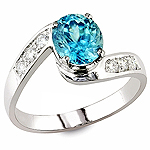 Blue zircon , white diamond and white gold ring.