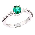 Green emerald and white diamond gold ring.
