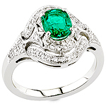 Green emerald white diamond and white gold ring.