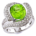 Peridot and white diamond gold ring.