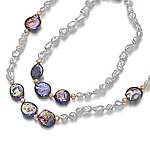 Raindrops of white, pink and black mabe pearls in an opera style necklace