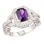 Violet sapphire and white diamond gold ring.